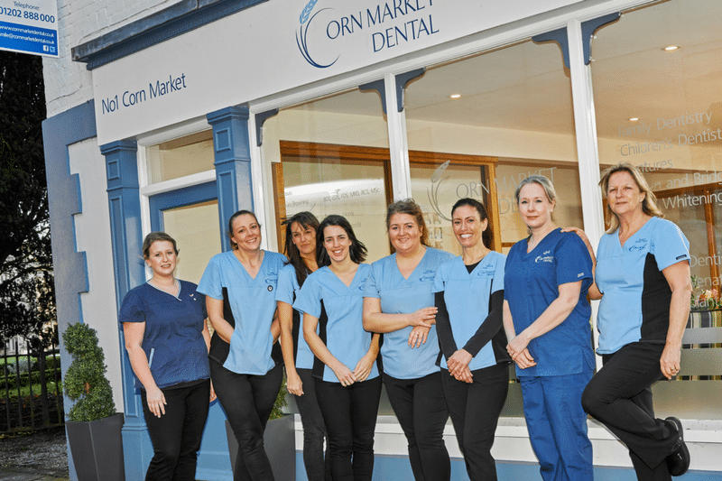 a photo of Corn Market Dental outside with the team