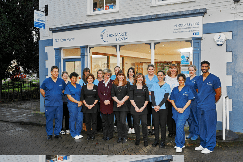 outside corn market dental full team photo