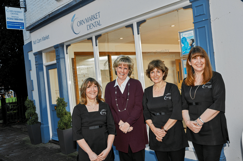 outside team photo of corn market dental